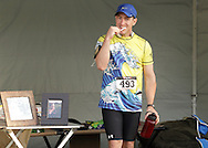 Augusta, New Jersey - A runner brushes his teeth during a 72-hour race during the 3 Days at the Fair races at Sussex County Fairgrounds on May 10, 2012.