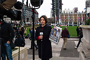 A news presenter holds a copy of The Sun Newspaper with the headline Our Time Has Come in Parliament Square, London, United Kingdom on 31st January, 2020. The United Kingdom formally leaves the European Union at 23:00 GMT today.