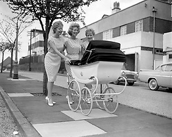 File photo dated 30/04/1959 of The Beverley Sisters (left to right) Babs, Joy and Teddie taking Joy's baby Victoria for a pram outing in Highgate, London. Babs Beverley of the Beverley Sisters has died at the age of 91.