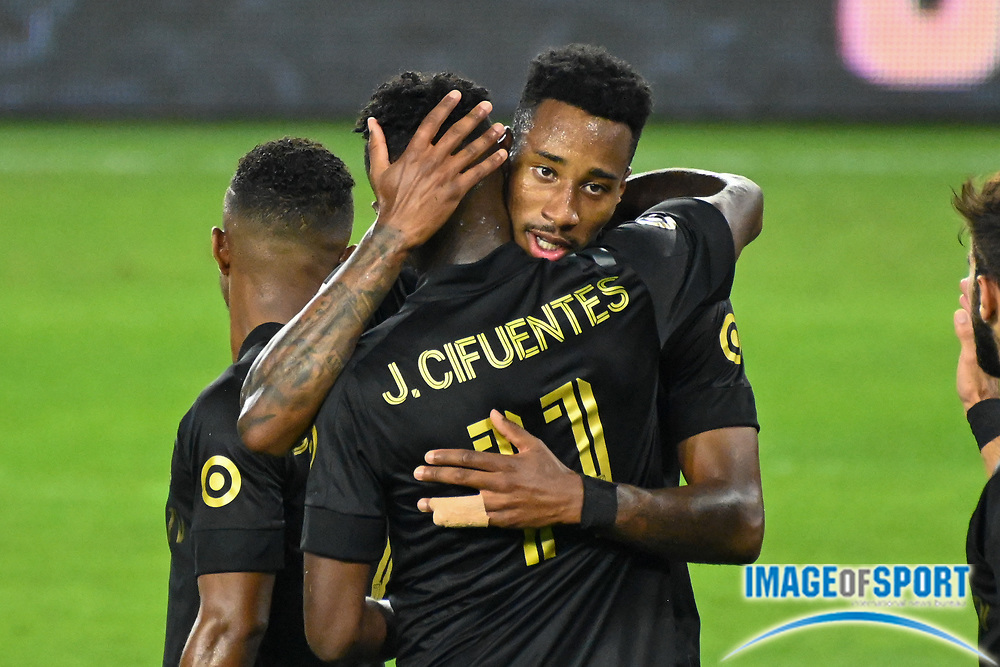 LAFC midfielder Mark-Anthony Kaye (14) embraces midfielder Jose Cifuentes (11) after Kaye scored a goal during a MLS soccer game, Sunday, Sept. 27, 2020, in Los Angeles. The San Jose Earthquakes defeated LAFC 2-1.(Dylan Stewart/Image of Sport)