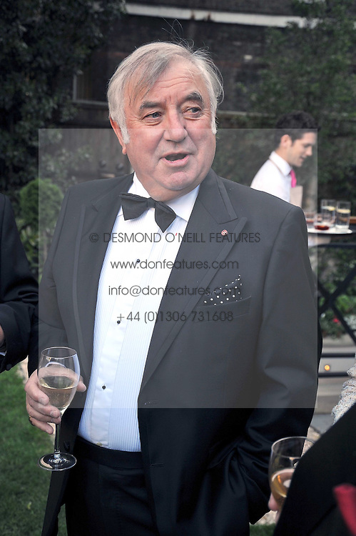 JIMMY TARBUCK at a reception for the Castle of Mey held at the Goring Hotel, London on 19th May 2009.