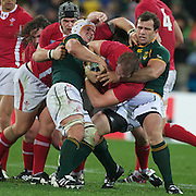 Alun Wyn Jones, Wales, is tackled by Heinrich Brussow, (left) and Bismarck Du Plessis, South Africa, during the Wales V South Africa, Pool D match during the Rugby World Cup in Wellington, New Zealand,. 11th September 2011. Photo Tim Clayton