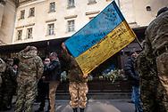 Ukrainian military veterans, two holding a Ukrainian flag, in Lviv, Ukraine.<br /><br />(October 14, 2015)