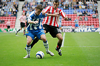 Photo: Peter Phillips.<br /> Wigan Athletic v Sunderland. The Barclays Premiership.<br /> 27/08/2005.<br /> Wigans Ryan Taylor keeps the ball away from Sunderlands Julio Arca
