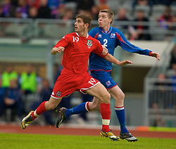 REYKJAVIK, ICELAND - Wednesday, May 28, 2008: Wales' Ched Evans and Iceland's Birkir Mar Saevarsson during the international friendly match at the Laugardalsvollur Stadium. (Photo by David Rawcliffe/Propaganda)