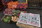 Looter and rioting headlines from the Sun newspaper in Clarence Road, Hackney. After the riots of London and other UK cities, Sri Lankan-born Sivaharan (Siva) Kandiah's looted shop 'Clarence Convenience Store' in Clarence Road, Hackney.