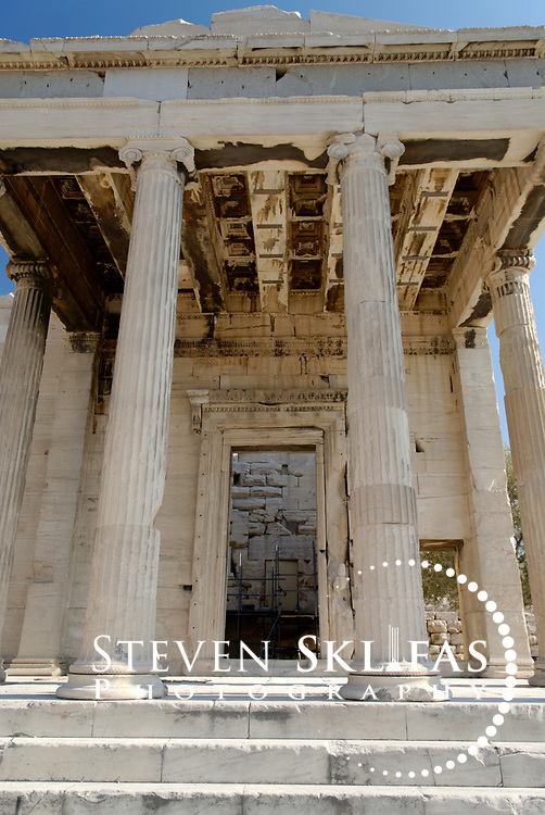 Acropolis. Athens. Greece. View of the elegant North porch Ionic columned portico of the Erechtheion on the Acropolis summit. Built between 420 and 406 BC, the elegant and unusually shaped Temple was designed to incorporate a number of ancient sanctuaries and cults including that of Athena and her olive tree and Poseidon-Erechtheus. The Erechtheion Temple was part of the monumental rebuilding and transformation of the Acropolis buildings during the time of Perikles. The Acropolis of Athens and its monuments are a UNESCO World Heritage Site.