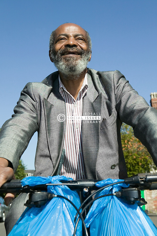 Elderly Man cycling with his shopping bags hanging on the handlebars,