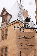 Restaurant Sign in the snow. Beaune. France .<br /> <br /> Visit our FRANCE HISTORIC PLACES PHOTO COLLECTIONS for more photos to download or buy as wall art prints https://funkystock.photoshelter.com/gallery-collection/Pictures-Images-of-France-Photos-of-French-Historic-Landmark-Sites/C0000pDRcOaIqj8E