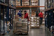 Employees organize pallets of food at the Second Harvest Heartland Headquarters in Brooklyn Park, Minnesota, U.S., on Thursday, July 23, 2020. Photographer: Ben Brewer/Bloomberg