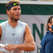 PARIS, FRANCE September 25.  Rafael Nadal of Spain watched by coach Carlos Moya during his practice match with Filip Krajinovic of Serbia on Court Philippe-Chatrier in preparation for the 2020 French Open Tennis Tournament at Roland Garros on September 25th 2020 in Paris, France. (Photo by Tim Clayton/Corbis via Getty Images)