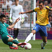 Sandro, Brazil, (right) is challenged by Oribe Peralta, Mexico, during the Brazil V Mexico Gold Medal Men's Football match at Wembley Stadium during the London 2012 Olympic games. London, UK. 11th August 2012. Photo Tim Clayton