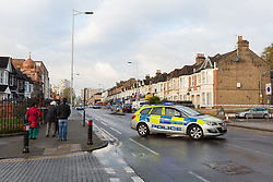 © Licensed to London News Pictures. 12/11/2017. LONDON, UK.  The police cordon and crime scene at High Road in Ilford. At 02:48 this morning, police were called to the scene, where a man had been beaten by a group of men with what is thought to have been baseball bats. The man was taken to an east London hospital by London Ambulance Service where he died at 04:35.  Photo credit: Vickie Flores/LNP