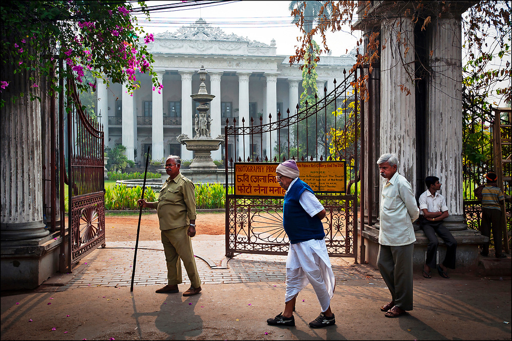 Calcuttans stroll past the Marble Palace, one of the best-preserved family mansions from a bygone era when Calcutta was capital of British colonial India.  For two hundred years, Bengali rajas and traders lived the narrow streets of North Calcutta, where the Marble Palace was an architectural showpiece. © Steve Raymer / National Geographic Creative
