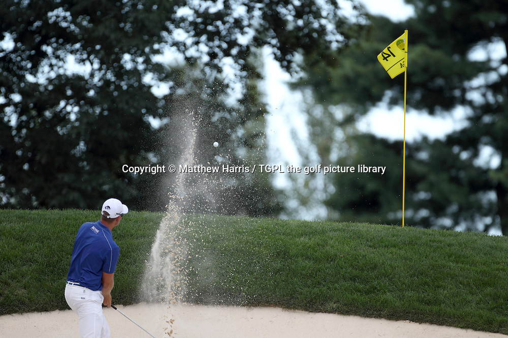 Henrik STENSON (SWE) hits trouble at 13th par 4 having hit his second shot from a divot into the front bunker during fourth round US PGA Championship 2013,Oak Hill CC,