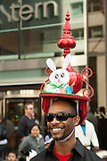 A man with an elaborate red decorative hat.