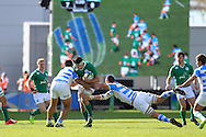 Max Deegan of Ireland breaks past the tackle from Vicente Boronat of Argentina (r). .World Rugby U20 Championship 2016,  Semi Final match,  Match 23  , Ireland U20's  v Argentina U20's at the Manchester city Academy Stadium in Manchester, Lancs on Monday 20th June 2016, pic by  Andrew Orchard, Andrew Orchard sports photography.
