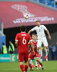 2017?6?17?.   ????????——???????????????.    6?17???????????????????????????.    ??????????????2017????????????A????????????2?0???????.    ?????????..(SP)RUSSIA-ST. PETERSBURG-2017 FIFA CONFEDERATIONS CUP-RUS VS NZL.(170617) -- ST. PETERSBURG, June 17, 2017  Kosta Barbarouses  (1st R) competes for a header during the group A match between Russia and New Zealand of the 2017 FIFA Confederations Cup in St. Petersburg, Russia, on June 17, 2017. Russia won 2-0.  7 9854294892 (Credit Image: © Xu Zijian/Xinhua via ZUMA Wire)