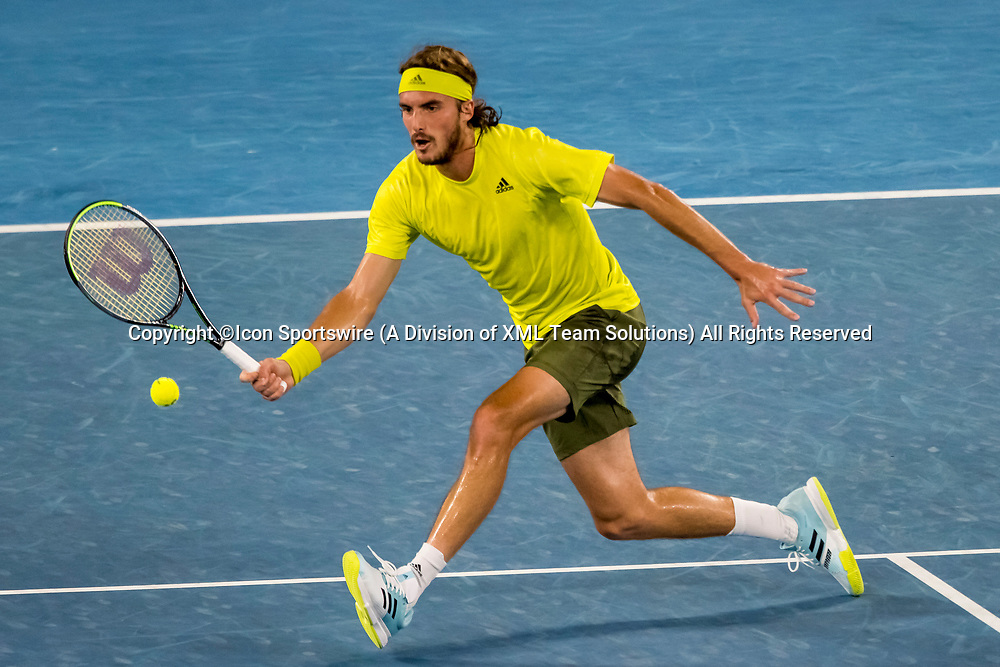 MELBOURNE, VIC - FEBRUARY 17: Stefanos Tsitsipas of Greece returns the ball during the quarterfinals of the 2021 Australian Open on February 17 2021, at Melbourne Park in Melbourne, Australia. (Photo by Jason Heidrich/Icon Sportswire)