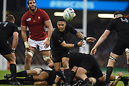Aaron Smith of New Zealand passes the ball.Rugby World Cup 2015 quarter-final match, New Zealand v France at the Millennium Stadium in Cardiff, South Wales  on Saturday 17th October 2015.<br /> pic by  Andrew Orchard, Andrew Orchard sports photography.
