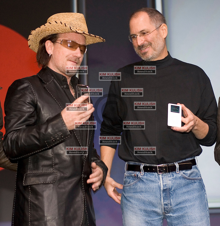 Bono ( L), Apple CEO Steve Jobs (R)   introduce the  iPod U2 Special Edition as part of a partnership between Apple, U2 and Universal Music Group (UMG) during a press conference in San Jose, California, October 26, 2004. The new special Edition U2 iPod which can hold up to 5,000 songs, and features a black enclosure with a red click wheel and custom engraving of U2 band member signatures. Photo By  Kim Kulish