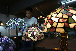 June 22, 2017 - Lianyungan, Lianyungan, China - Lianyungang, CHINA-June 22 2017: (EDITORIAL USE ONLY. CHINA OUT)..Zhao Zhonggang, the 23-year-old village official, makes beautiful crystal lamps with abandoned crystal in Donghai County, east China's Jiangsu Province. (Credit Image: © SIPA Asia via ZUMA Wire)