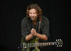 American actor Bradley Cooper filming scenes from A Star is Born on the Pyramid Stage, before Kris Kristofferson takes to the stage, at the Glastonbury Festival at Worthy Farm in Pilton, Somerset.
