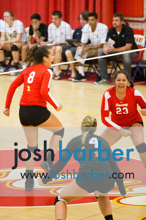 Melissa Diaz, Kara Turtzer, Brittney Pinzon during a non-league girl's volleyball match between the Canyon Comanches and Rosary Royals at Rosary Academy on Thursday, September 17, 2015 in Fullerton, California.