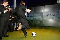 11 APR 2005 HANNOVER/GERMANY:<br /> Utz Claassen (L), Vorstandsvorsitzender EnBW, und Gerhard Schroeder (S), SPD, Bundeskanzler, der an einem Simulator fuer Elfmeterschiessen Fussball spielt, am Messestand von Energie Baden-Wuerttemberg, EnBW, Hannover Messe<br /> IMAGE: 20050411-01-015<br /> KEYWORDS: Gerhard Schröder