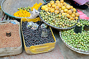 Fruit and spices for sale at the early morning market on the streets of Patan, Nepal.