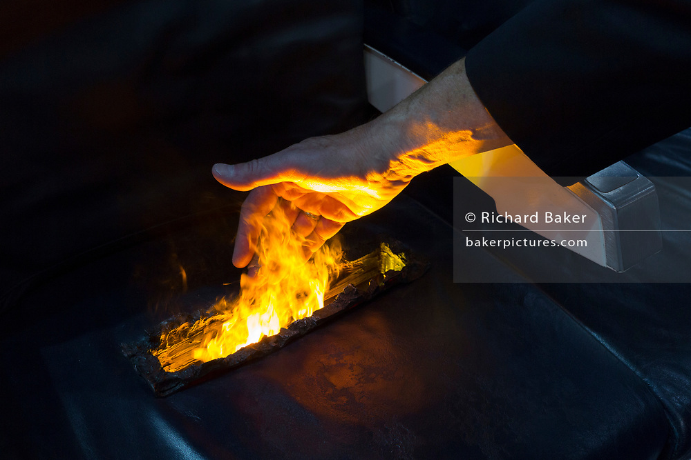An exibition demonstration stunt by Resonate Testing Ltd. to illustrate that they test and contribute with the certification of fire-retardant airline seat materials, at the Farnborough Airshow, on 16th July 2018, in Farnborough, England.