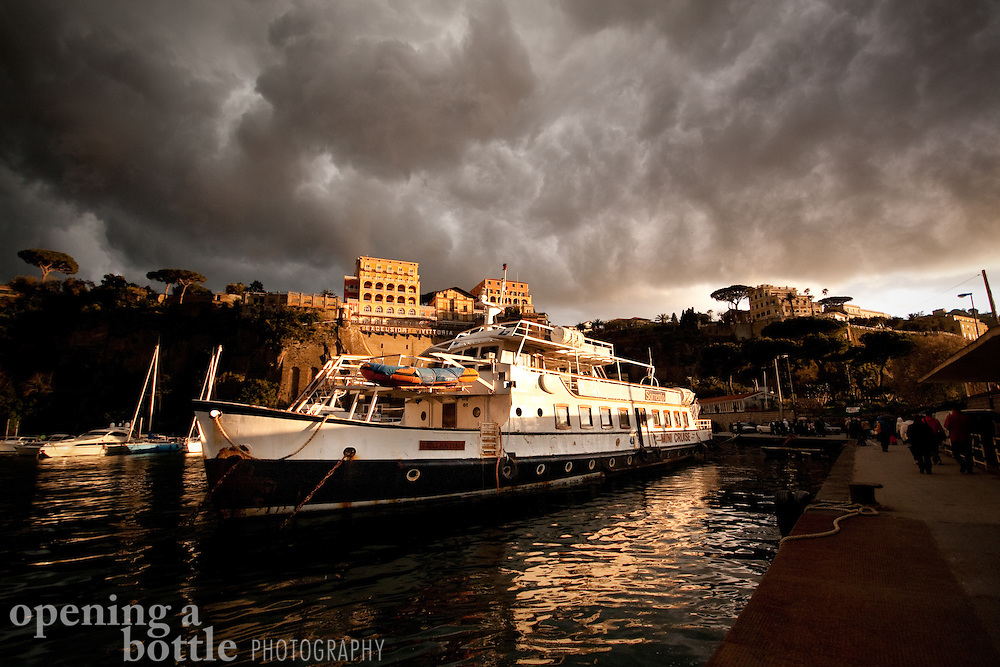A severe thunderstorm builds over the boats at harbor in Sorrento, Campania, Italy.