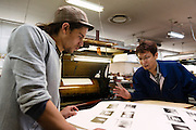 Photographer Antony Cairns discussing one of his collotype prints with printer Masaaki Ishibe. Benrido collotype atelier, Kyoto, Japan, October 9, 2015. The Benrido collotype atelier in Kyoto was founded in 1887 and is the only full-scale commercial collotype atelier in the world. Collotype is a historic photographic printing process that makes use of plates coated in gelatine. It produces prints of unrivalled quality.