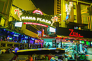 """18 JANUARY 2013 - BANGKOK, THAILAND:  The entrance to the Nana Entertainment Plaza on Sukhumvit Soi 4 in Bangkok. Prostitution in Thailand is illegal, although in practice it is tolerated and partly regulated. Prostitution is practiced openly throughout the country. The number of prostitutes is difficult to determine, estimates vary widely. Since the Vietnam War, Thailand has gained international notoriety among travelers from many countries as a sex tourism destination. One estimate published in 2003 placed the trade at US$ 4.3 billion per year or about three percent of the Thai economy. It has been suggested that at least 10% of tourist dollars may be spent on the sex trade. According to a 2001 report by the World Health Organisation: """"There are between 150,000 and 200,000 sex workers (in Thailand).""""    PHOTO BY JACK KURTZ"""