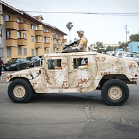 Heavily armed Mexican Army vehicles patrol Tijuana, currently the most violent city in the world.