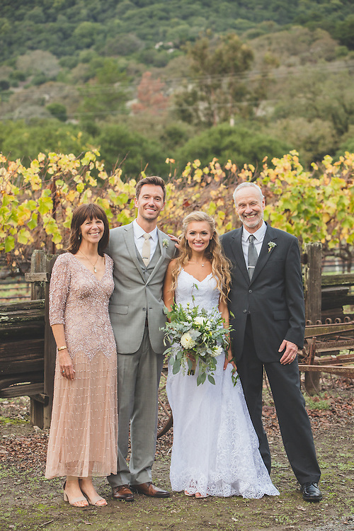 Milo and Jillian dodge the rain in the October Vineyard wedding. Beautiful Sonoma county colors surround the couple at the Crane Melon Barn...a perfect place for a fall wedding.
