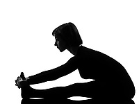 woman paschimottanasana yoga pose posture position in silouhette on studio white background full length