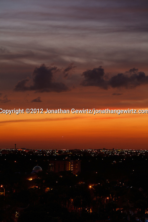 Miami International Airport and the western Miami, Florida skyline shortly after sunset. WATERMARKS WILL NOT APPEAR ON PRINTS OR LICENSED IMAGES.