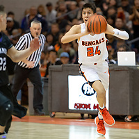 Gallup Bengals Gallup Bengals Quinn Atazhoon (24) looks to pass from center court during the 4A -District Tournament Championship game at Gallup High School Saturday.