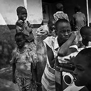 Young boys gather outside the local health clinic in Kaaleng village in the Turkana region of northwestern Kenya. Photo: Sanjit Das/Panos