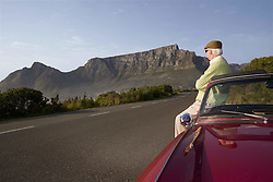March 20, 2016 - Senior man admires view leaning on vintage racing car on Signal Hill  Cape Town  South Africa  (Credit Image: © Craig Campbell/DPA via ZUMA Press)
