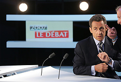 French Presidential candidate UMP right-wing Nicolas Sarkozy waits, 02 May 2007 for the start of the two-hour face-to-face debate with Socialist Segolene Royal on the SFP tv set in Boulogne-Billancourt, west of Paris. France has a tradition of TV duels between presidential candidates, which have sometimes swung the election for one of the candidates, but Royal is the first woman to take part in one. Photo pool by Thomas Coex/ABACAPRESS.COM