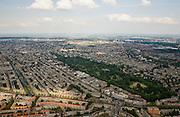 Nederland, Amsterdam, Oud-Zuid, 17-06-2008; overzicht van Oud-West: onder in beeld Surinameplein en brug over de Kostverlorenkade, begin van de Overtoom (diagonaal naar links / het midden); rechts van de Overtoom het Vondelpark en Oud-Zuid; het water links (en naar boven toe)is de Jacob van Lennep kade; buurten die in beeld komen zijn onder andere: Van Lennepbuurt, Helmersbuurt, Overtoomse Sluis / Cremerbuurt, Vondelbuurt; de foto strekt zich uit tot IJburg (in het midden in de zon) en het IJsselmeer..luchtfoto (toeslag); aerial photo (additional fee required); .foto Siebe Swart / photo Siebe Swart