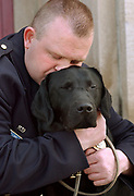 Cit4/8/04  Photo by Mara Lavitt--Rob & Major<br /> ML0122E #1866<br /> New Haven Police Officer Robert Fumiatti with his drug dog Major after their graduation from the State Police Canine Training Unit in Meriden.
