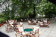 Greece, Thessaly, Tsagarada on the slopes of mount Pelion A outdoor restaurant in the shade of a large Platan tree in the city center