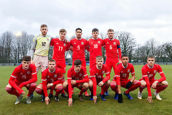 BANGOR, WALES - Tuesday, November 20, 2018: Wales players line up for a team group photograph before the UEFA Under-19 Championship 2019 Qualifying Group 4 match between Wales and San Marino at the Nantporth Stadium.  Back row L-R: goalkeeper Adam Przybek, Ryan Astley, Ben Cabango, Jay Foulston, captain Brandon Cooper.  Front row L-R: Jack Vale, Daniel Griffiths, Sam Bowen, Ryan Stirk, Brennan Johnson, Lewis Collins. (Pic by Paul Greenwood/Propaganda)