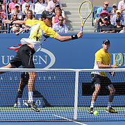 Brothers Bob Bryan and Mike Bryan, USA, in action against Leander Paes, India, and Radek Stepanek, Czech Republic, during the Men's Doubles Semifinals match at the US Open. Flushing. New York, USA. 5th September 2013. Photo Tim Clayton
