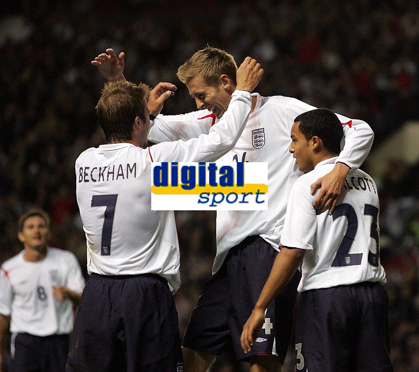 Photo: Paul Thomas.<br /> England v Hungary. International Friendly. 30/05/2006.<br /> <br /> Peter Crouch (C) of England celebrates his goal with David Beckham and Theo Walcott (R).