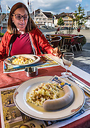 The traditional Appenzell sausage and macaroni dinner is served at Hotel Cafe Adler, family-run since 1820, in Appenzell village, Switzerland, Europe. Appenzell Innerrhoden is Switzerland's most traditional and smallest-population canton (second smallest by area). For licensing options, please inquire.