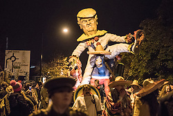© Licensed to London News Pictures. 05/11/2016. Lewes, UK. An effigy of Donal Trump is carried through the streets of Lewes in East Sussex before being burnt. The celebrations, which mark the Guy Fawkes 1605 Gunpowder Plot to blow up Parliament, date back to the 1850s. Photo credit: Rob Pinney/LNP